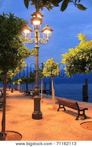 Burning Lantern At The Lakeside Promenade Of Garda Lake, Italy