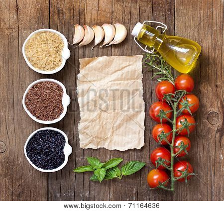 Variety Of Rice In Bowls And Old Paper