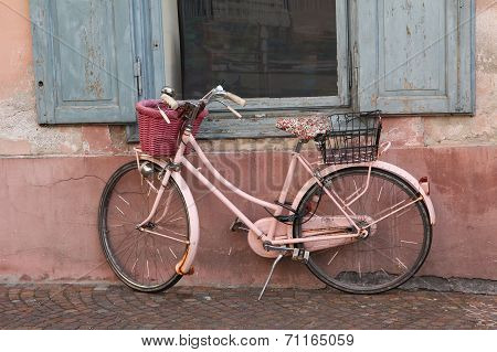 Nostalgic Pink Bike Against House Facade