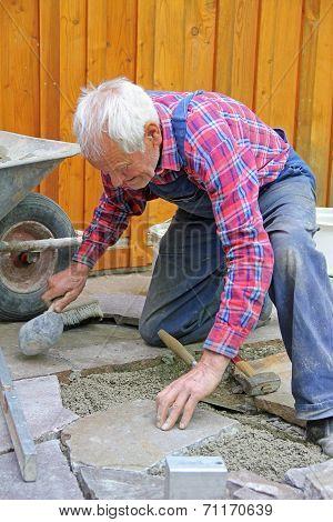 Aged Senior, Paving A Patio, Professional Precision Work