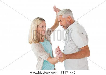 Angry man overpowering his partner on white background