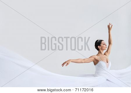 Young ballet dancer with white plume