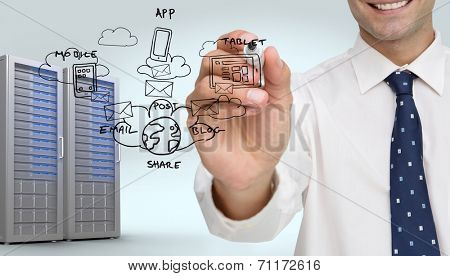 Businessman writing on camera with a black marker pen against digitally generated server tower