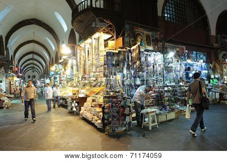 ISTANBUL, TURKEY - JUNE 23, 2012: People in the Spice Bazaar. It's the second largest covered shopping complex in the city after the Grand Bazaar
