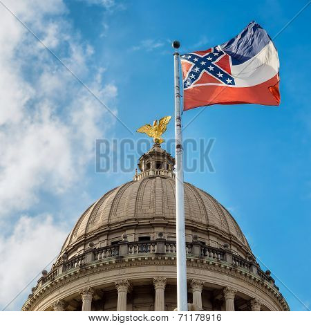 Mississippi State Flag Flying In Front Of Capitol Building In Jackson