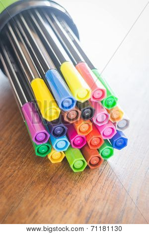 Colorful Magic Pens On Wooden Table