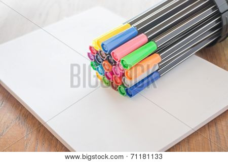 Colorful Magic Pens On Sheet Paper