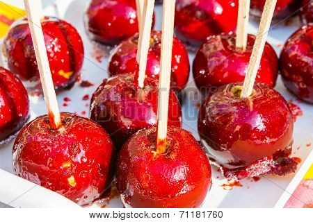 Caramelized Red Apples On Wooden Sticks