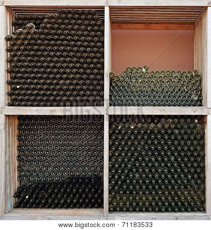 Rows of many empty wine bottles. Abstract background