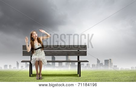 Asian pretty scarred woman sitting on bench