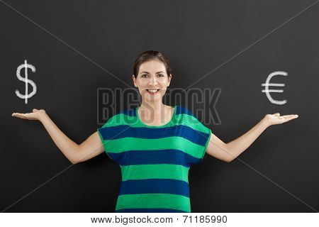 Happy woman in front of a chalkboard ilustrating a concept about money currency