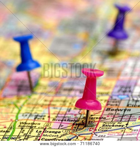 Map with thumb tacks showing locations