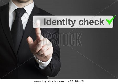 Businessman Pushing Button Identity Check