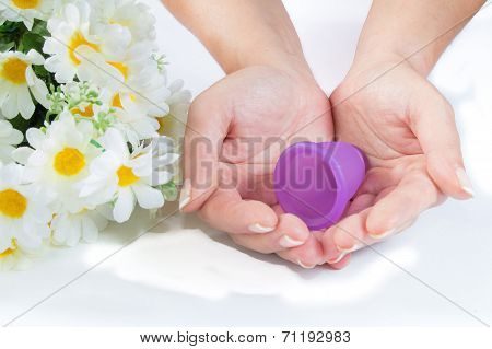 Hands, Menstrual Cup And Flowers.
