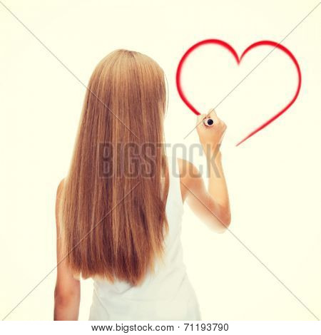 education, new technology and advertisement concept - teenage girl in white shirt from the back drawing heart on virtual screen