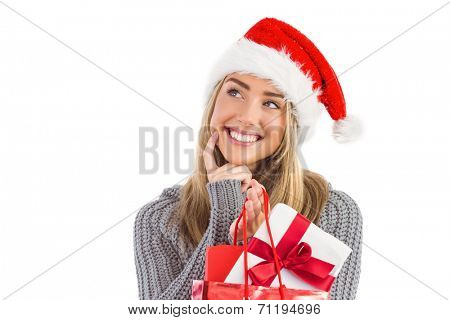 Festive blonde holding christmas gift and bag on white background