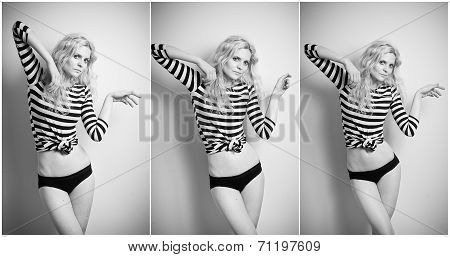 Attractive sexy blonde in black and white tight fit blouse and bikini posing provocatively