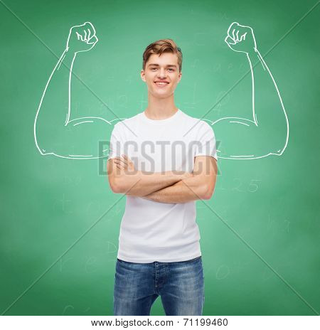 t-shirt design, education, school, advertising and people concept - smiling young man in blank white t-shirt over green board background strong arms drawing