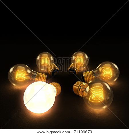 One Bright Bulb Amoung Six Incandescent Lightbulbs In A Circle On Dark Background