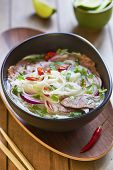 pic of rice noodles  - Pho bo, Vietnamese food, rice noodle soup with sliced beef