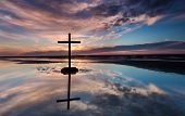 picture of tide  - Black cross at low tide on a beach as the sunsets - JPG
