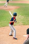 foto of hitter  - Teen baseball boy at the plate watching the ball - JPG