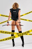 image of vest  - back side of sexy police woman with bulletproof vest - JPG