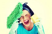 stock photo of screaming  - Tired frustrated and exhausted cleaning woman screaming  - JPG
