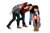 stock photo of school bullying  - Group of children bullying an isolated child - JPG