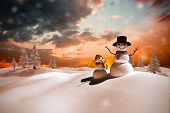 pic of snow clouds  - Composite image of snow family against orange and blue sky with clouds - JPG