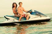image of jet-ski  - Multi ethnic couple sitting on a jet ski - JPG