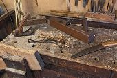 stock photo of carpenter  - woodworking tools of antique carpentry - old bench with carpenter