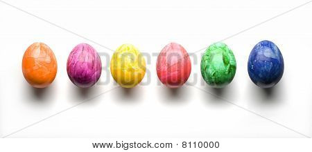 Six Eastereggs In A Row Isolated On White With Clipping Path