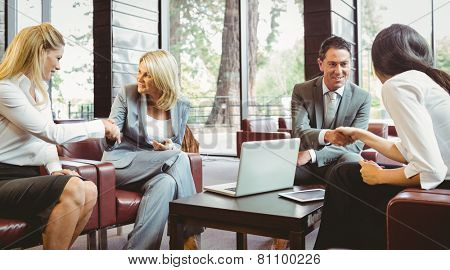 Busines people shaking hands after meeting in the office