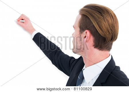 Well dressed businessman writing with chalk on white background