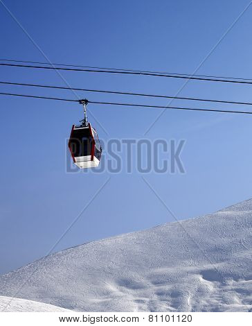 Gondola Lift And Off Piste Slope At Sun Morning