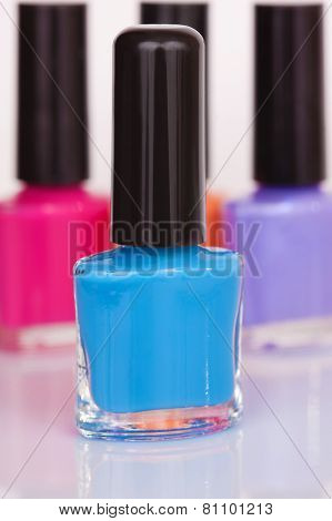 Three Multi-colored Nail Polish