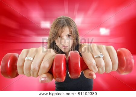 Girl With Weights Or Red Dumbbells Wearing Sports Clothing Isolated Over Red