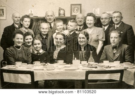 GERMANY, CIRCA THIRTIES: Vintage photo of big family during a family meal