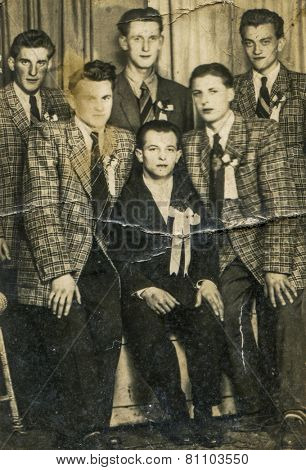 GERMANY, APRIL 25, 1954: Vintage photo of groom with his groomsmen