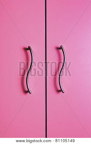 Colored door with two metal handles