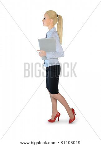 Isolated business woman walking with laptop