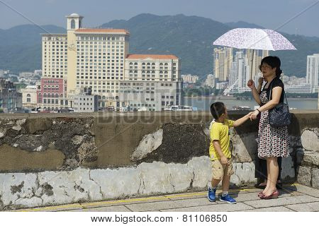 People enjoy the view to downtown Macau, China.