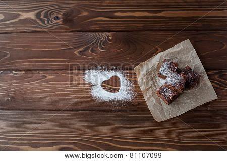 Chocolate brownie with powdered sugar heart