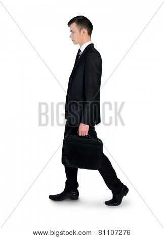 Isolated business man walking side