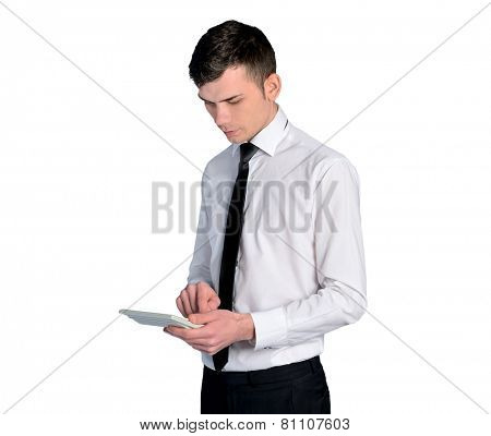 Isolated young business man calculating