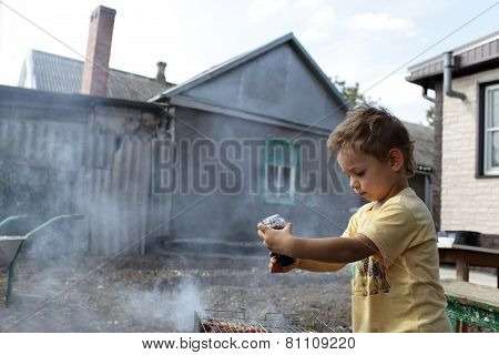 Child Seasoning Pork Chops With Pepper