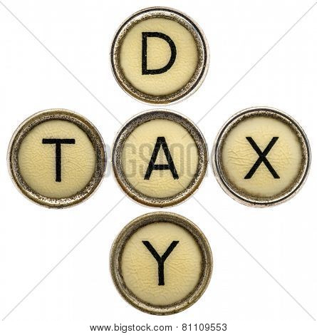 tax day crossword in old round typewriter keys isolated on white