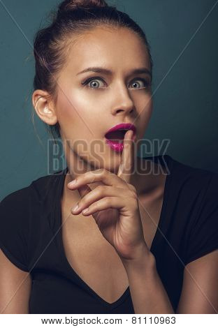 Beautiful woman show silence gesture