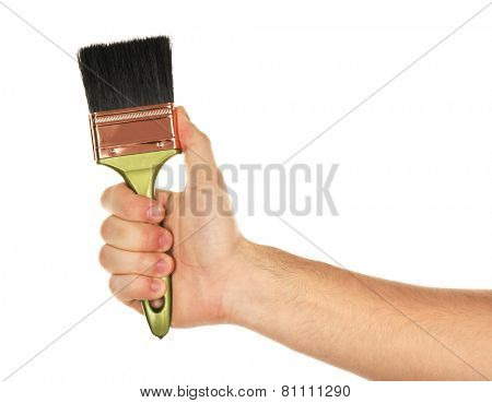 Paintbrush in male hand isolated on white